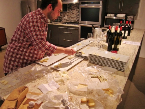 Marco Villegas prepares the cheese plates