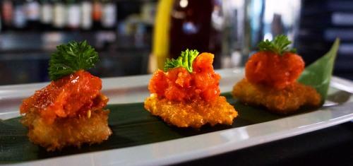 Salmon Tartare on Crispy Rice 5$