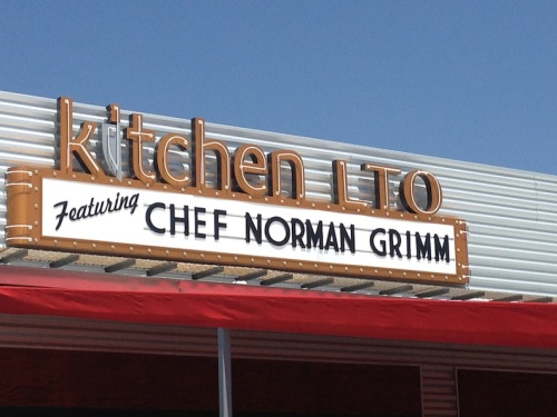 exterior sign featuring norm