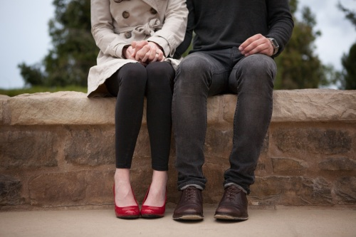 couple-holding-hands-sitting2